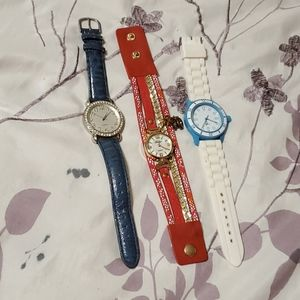 3 watches, blue, red and teal. Some wear on bands.